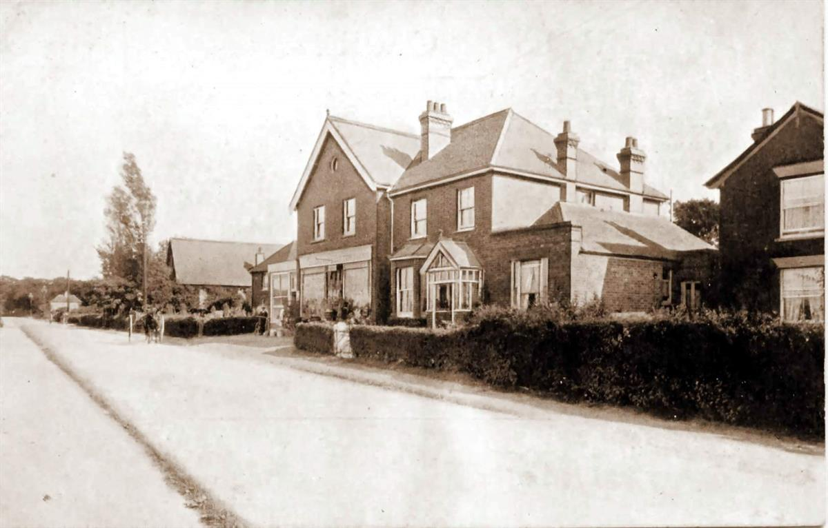 main road facing potten farm in the 1900's
